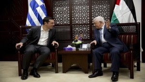 Greek Prime Minister Alexis Tsipras (L) meets Palestinian President Mahmoud Abbas in the West Bank city of Ramallah November 26, 2015. REUTERS/Majdi Mohammed/Pool - RTX1VYWK