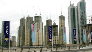 (FILES) -- A general view taken on 07 April 2006 of Dubai's Marina area shows several high-rise buildings being built by UAE-based EMAAR, the world's largest real estate company in terms of market capitalisation. Dubai's debt woes spread from the stock market to the corporate sector on December 9, 2009, with giant property developer Emaar cancelling plans to merge with state-owned Dubai Holding, describing the link-up as unfeasible. The decision by Emaar, developer of Burj Dubai, the world's tallest building, appears to reflect ebbing investor confidence in the debt-ridden emirate. AFP PHOTO/RABIH MOGHRABI (Photo credit should read RABIH MOGHRABI/AFP/Getty Images)